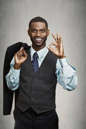 30522325-confidence-charisma-closeup-portrait-cheerful-young-african-man-in-full-suit-giving-ok-sign-gesture-